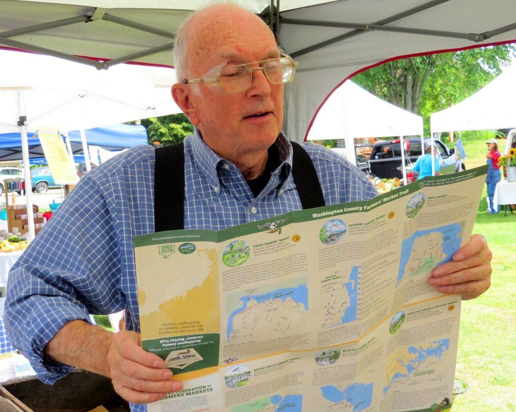 Historian John Dudley examines the FM Trail map.